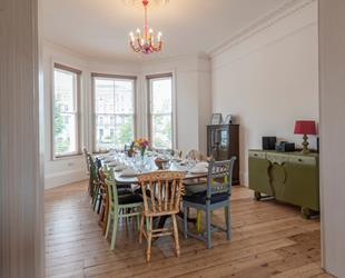 Magical Margate Dining Room with large round table laid out for breakfast